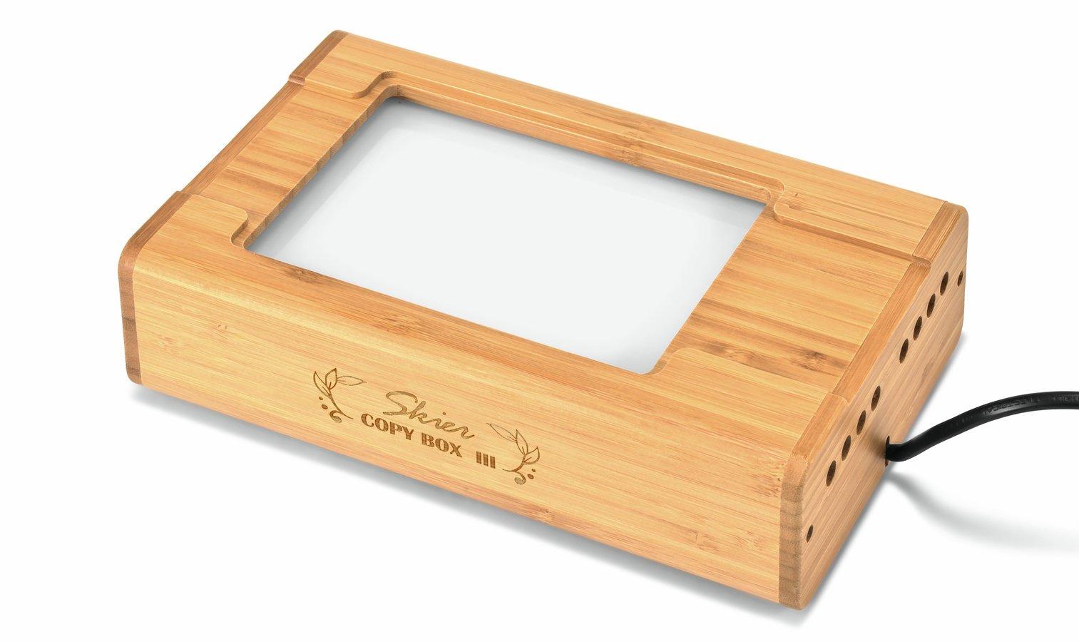 Die Sunray Copy Box II wird mit Handschuhen und Blasebalg geliefert.